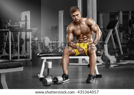 Sexy muscular man in gym, shaped abdominal. Strong male naked torso abs, working out - stock photo