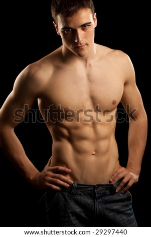 Sexy muscular man isolated on black - stock photo