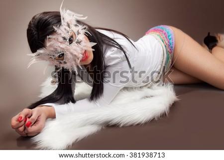Sexy mysterious woman wearing venetian mask - stock photo
