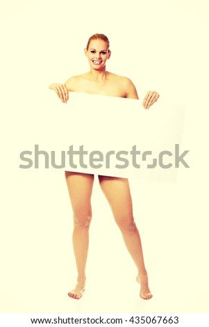 Sexy naked blonde holding empty board - stock photo