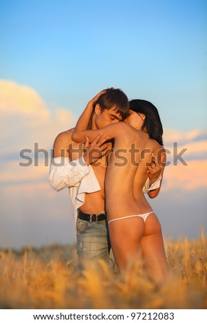 Sexy passion between two lovers on wheat field - stock photo