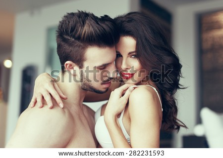 Sexy passionate couple foreplay at home, milf with young lover - stock photo