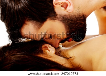 Sexy passionate heterosexual couple embracing in bed. - stock photo