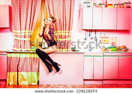 Sexy pin-up girl talking on the phone on a pink kitchen. Retro style ...: http://shutterstock.co.in/s/chitchat/search.html