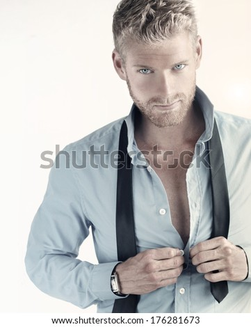 Sexy portrait of a young confident businessman - stock photo