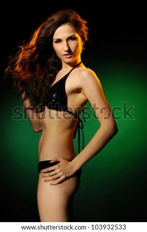Sexy posing young girl in underwear, studio shot - stock photo