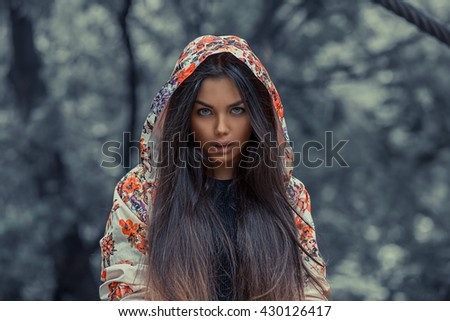 Sexy pretty and successful. Closeup portrait head shot beautiful brunette young woman looking at you isolated green trees nature background wall Positive human emotion face expression feeling life - stock photo