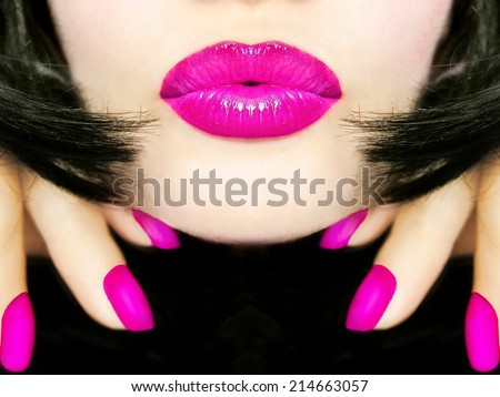 Sexy pretty woman with black hair, pink lips sending kiss smooch  - stock photo