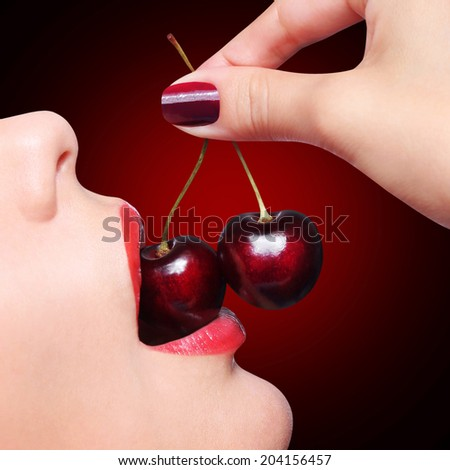Sexy Red Lips with Cherry over black background - stock photo