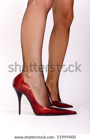 Sexy red shoes on sexy legs - stock photo