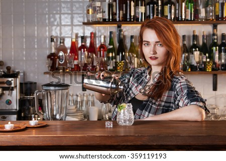 Sexy redhead bartender - stock photo