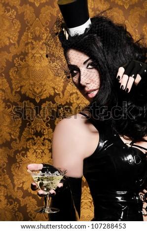 Sexy Retro Cabaret - Glamorous Vixen holding a Vintage Glass - stock photo