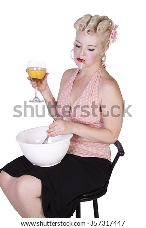 Sexy Retro Woman Drinking Wine and Smoking while Cooking - Isolated Background - stock photo