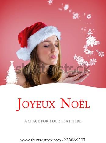 sexy santa girl blowing over hands against joyeux noel - stock photo