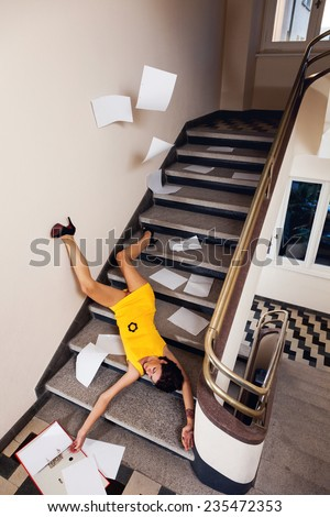 Sexy secretary fell down the stairs - stock photo