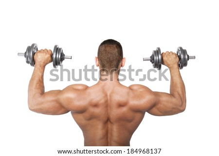 Sexy shirtless bodybuilder holding dumbbell, back view. Health, sports and fitness. - stock photo