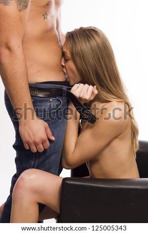 Sexy slim blonde woman undressing her boyfriend - stock photo