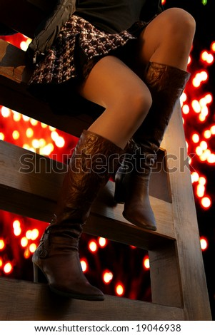 sexy slim legs on the carnival fireworks sky - stock photo