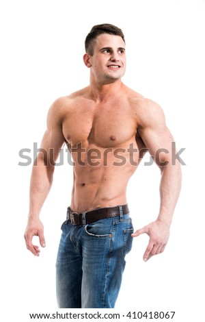 Sexy smiling shirtless male model with muscular body and abs against isolated white background looking outside - stock photo