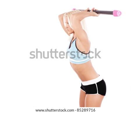 Sexy sportswoman does exercises, isolated on white - stock photo