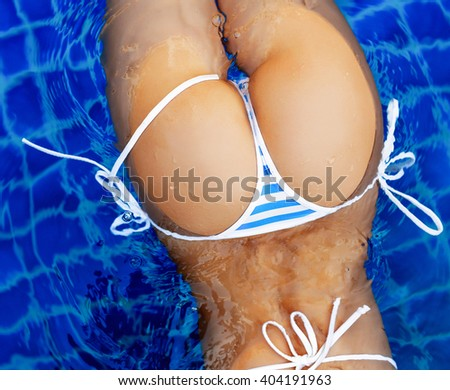 Sexy sporty tanned back closeup in bikini swimming in the pool summer outdoor picture  - stock photo