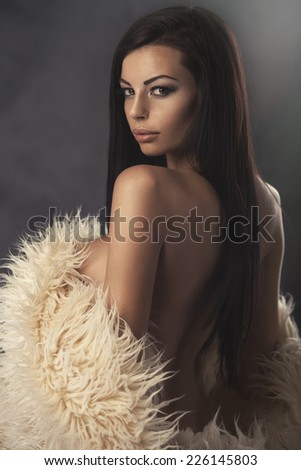 Sexy strict woman with sheepskin coat  - stock photo