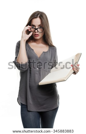 Sexy Student Girl Looking Surprised with a Vintage Book, Isolated on White - stock photo