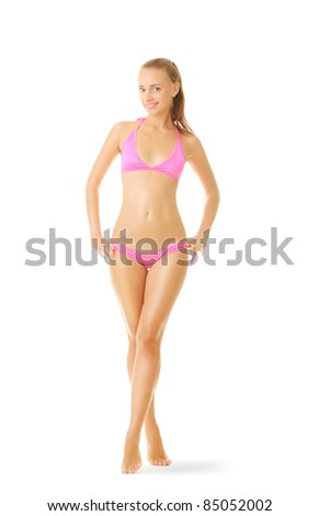 Sexy tan woman full length portrait in bikini isolated on white background, soft shadow - stock photo
