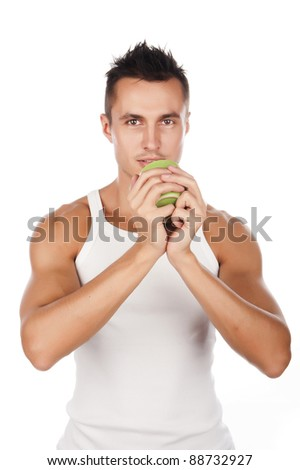 sexy tanned young man in a white shirt with a mug in hand,drink the drink,isolated over white - stock photo