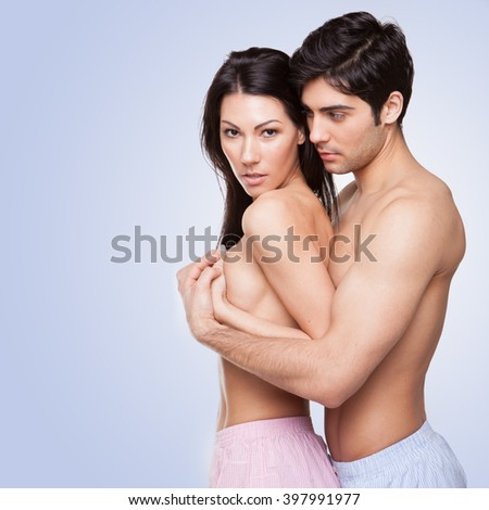 sexy topless couple in love wearing boxers  - stock photo