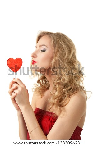 Sexy valentine girl holding heart candy - stock photo