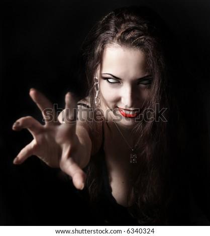 sexy vampire-girl on black background - stock photo