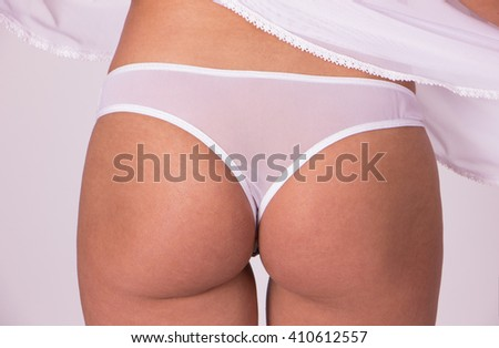 Sexy white t-back on caucasian girl, clse up shot - stock photo
