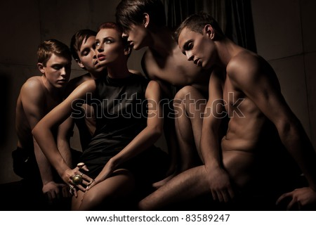 Sexy woman among group of man - stock photo