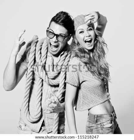 sexy woman and man screaming - black and white photo - stock photo