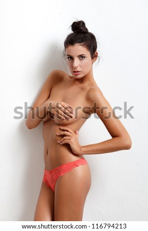 Sexy woman at white wall - stock photo