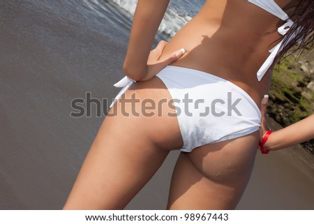 sexy woman back with white lingerie on seashore - stock photo