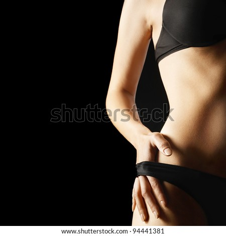 Sexy woman body lingerie isolated on black background. - stock photo