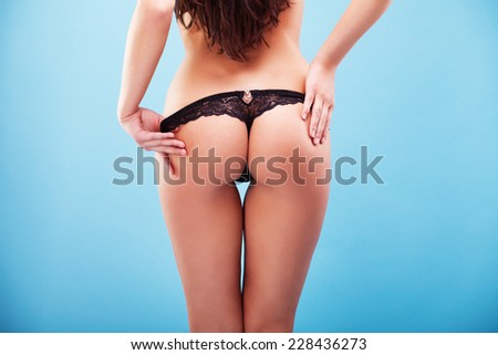 Sexy woman buttocks on the blue background  - stock photo