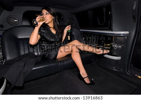 Sexy woman drinking Champagne. - stock photo