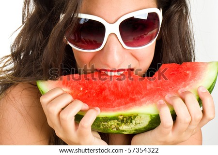 Sexy woman eating watermelon - summer concept - stock photo