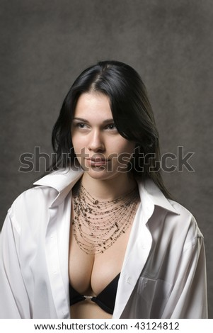 Sexy woman in a man's white shirt. - stock photo