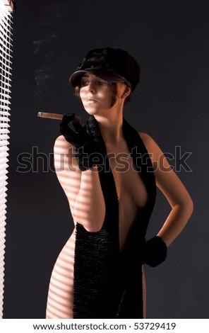 sexy woman in black astrakhan smoking cigar - stock photo