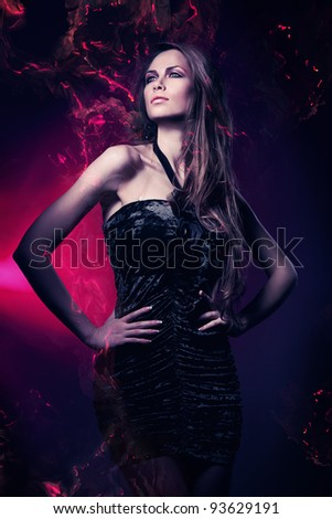 sexy woman in black dress in violet lights - stock photo