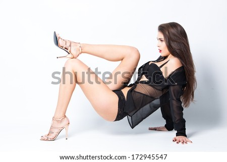 sexy woman in black lingerie,  transparent shirt  and high heel shoes full body shot, studio - stock photo