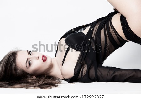 sexy woman in black lingerie,  transparent shirt, studio shot - stock photo
