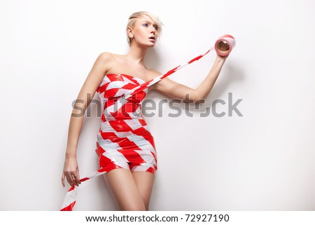 Sexy woman in dress made of tape - stock photo