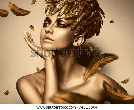 sexy woman in feather gold hat - stock photo