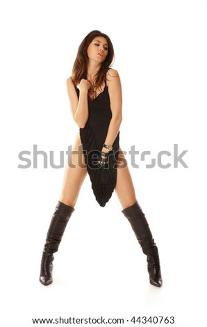 Sexy woman in fetish wear isolated on white - stock photo