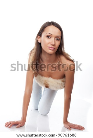 Sexy woman in jeans  and fur looking - stock photo